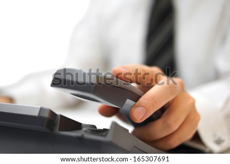 businessman is answering the phone - stock photo