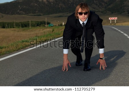 Businessman is at the start of running. Business struggle concept. - stock photo