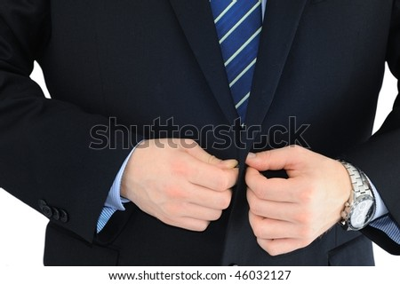 Businessman is buttoning up his suit isolated on white