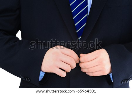 Businessman is buttoning up his suit isolated over white