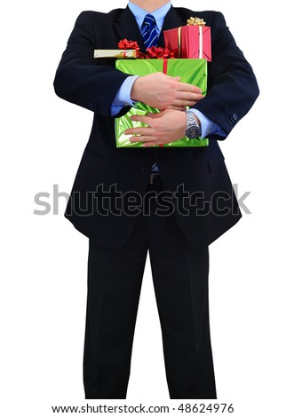 Businessman is carrying a bunch of gifts - stock photo