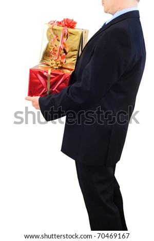 Businessman is carrying big presents - stock photo