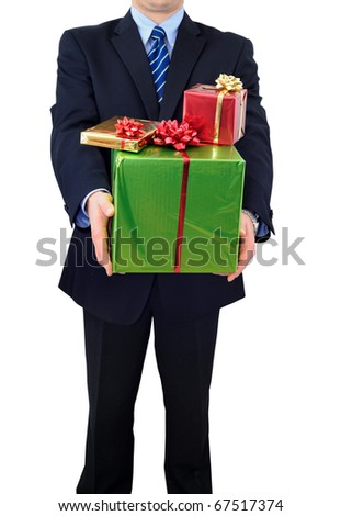 Businessman is carrying stock of presents - stock photo