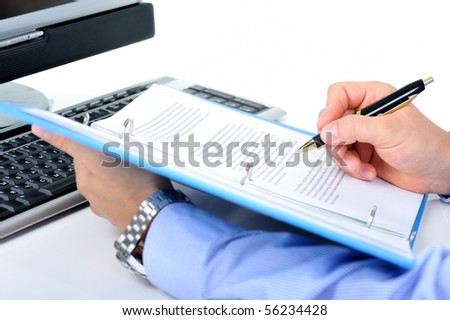 Businessman is checking a paperwork and making notes - stock photo