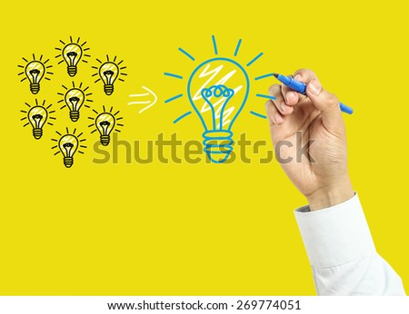 Businessman is drawing business concept with marker on transparent board with yellow background. - stock photo