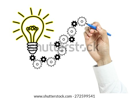 Businessman is drawing light bulb and gears with blue marker on transparent board isolated on white background. - stock photo