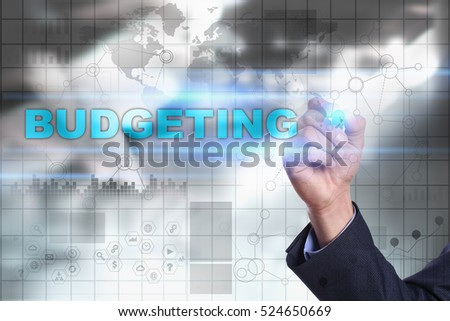 Businessman is drawing on virtual screen. budgeting concept.