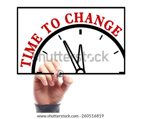 Businessman is drawing the concept of time to change on transparent white board. - stock photo