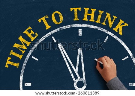 Businessman is drawing the concept of time to think on chalkboard. - stock photo