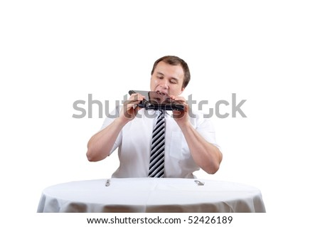 Businessman is eating notebook on lunch, isolate white background. - stock photo