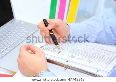 Businessman is filling out the 1040 tax form - stock photo