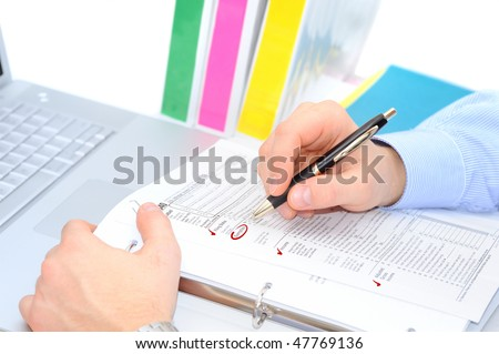 Businessman is filling out the tax form - stock photo