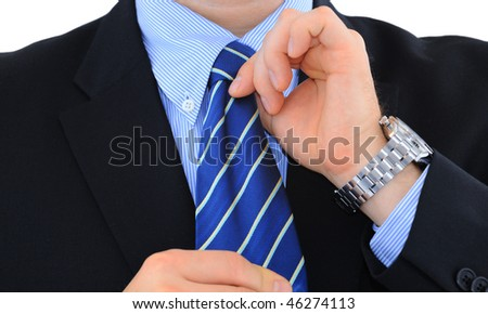 Businessman is fixing his necktie isolated over white - stock photo