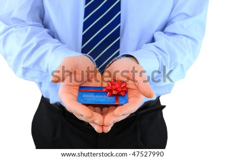 Businessman is giving a credit card - stock photo