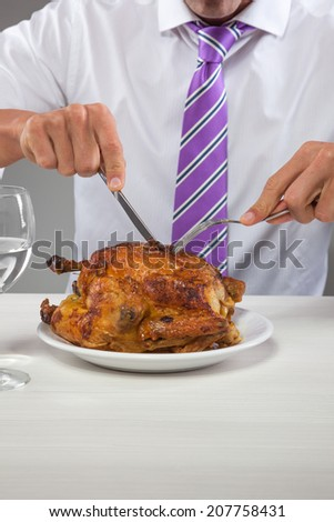businessman is going to eat a roast chicken.