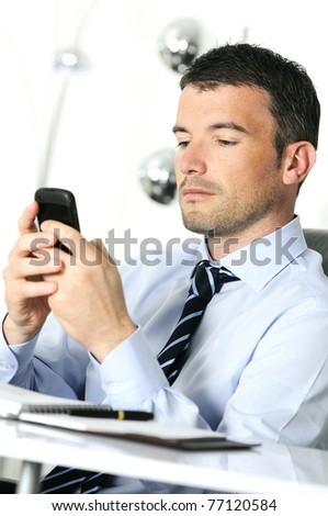 businessman is having a communication with his cellphone - stock photo
