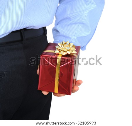 Businessman is hiding a gift behind his back - stock photo