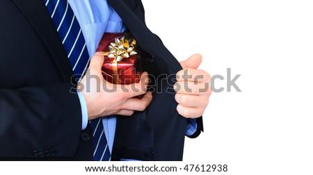 Businessman is hiding a present - stock photo
