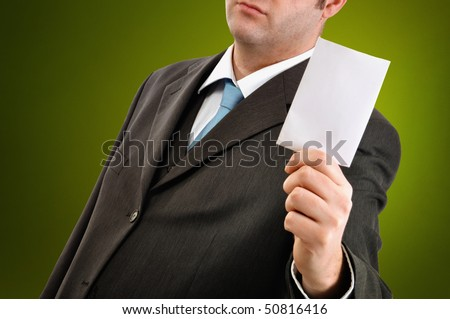 Businessman is holding a blank business card