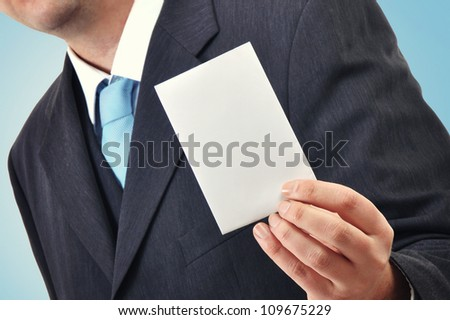 Businessman is holding a blank business card, cpy space for your design