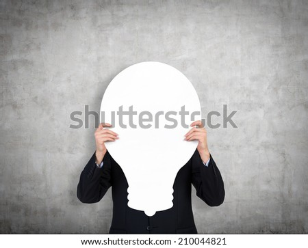 Businessman is holding a blank placard of a lightbulb. A concept of innovative ideas. - stock photo