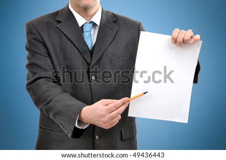 Businessman is holding a piece of blank white paper, business presentation scene