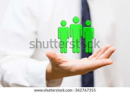 businessman is holding virtual wining team, staffing and human resources concept - stock photo