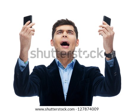 Businessman is in mess with phones - stock photo