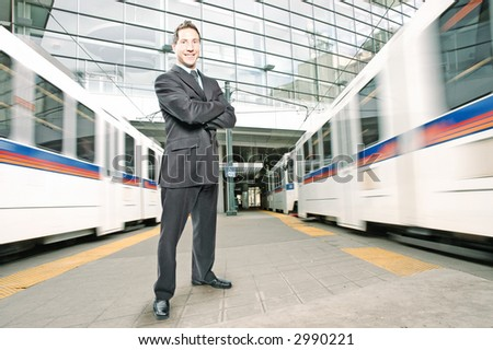 businessman is in the middle of two trains during rush hour