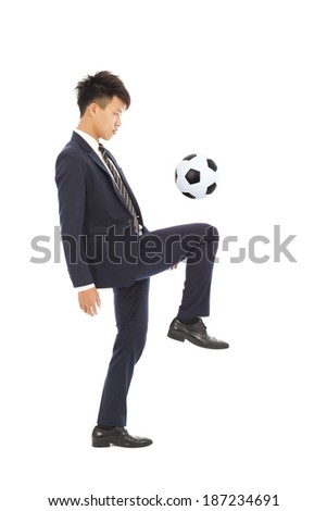 businessman is kicking a soccer - stock photo