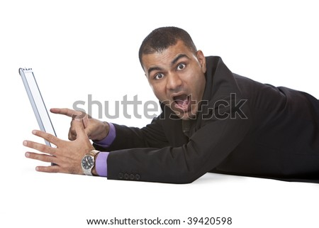 Businessman is lying and found something suprising on his notebook. Isolated on white. - stock photo