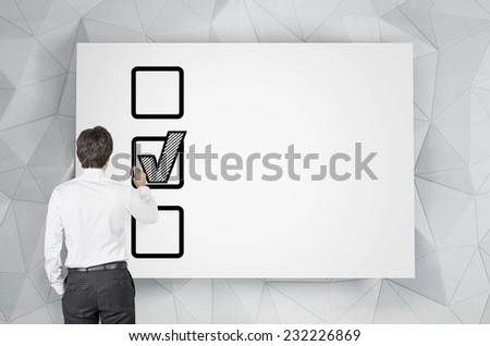 Businessman is making a choice. Whiteboard. - stock photo