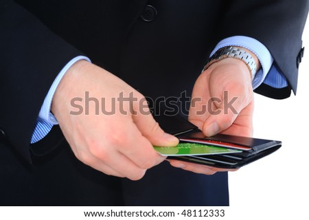 Businessman is paying with credit card isolated on white - stock photo