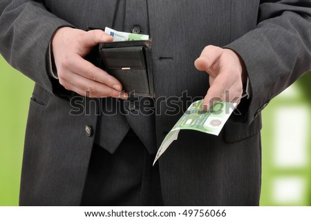 Businessman is paying with euro banknotes, financial background - stock photo