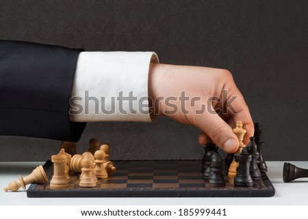 Businessman is playing against the rules - stock photo