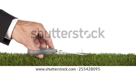 Businessman is preparing the green . Metaphor for service and perfection. With copy space - stock photo