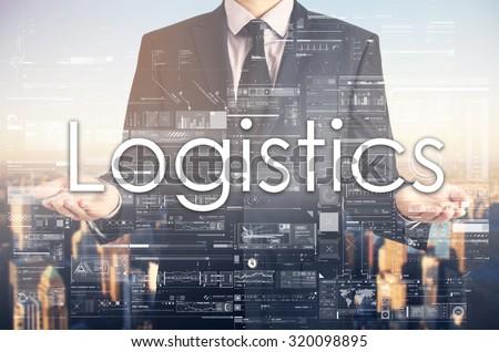 Businessman is presenting text: Logistics - stock photo