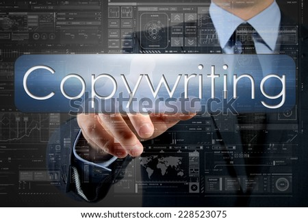 businessman is pressing a button with the inscription: Copywriting , in background are some graphs and diagrams - stock photo