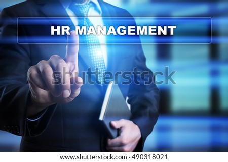 "Businessman is pressing button on touch screen interface and selecting ""HR management"". Business concept."