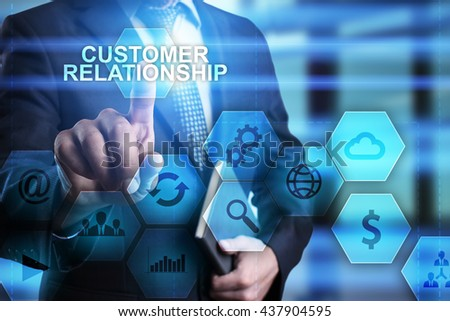 """Businessman is pressing on the virtual screen and selecting """"Customer relationship"""". - stock photo"""