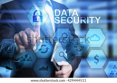 Businessman is pressing on the virtual screen and selecting Data security.  - stock photo