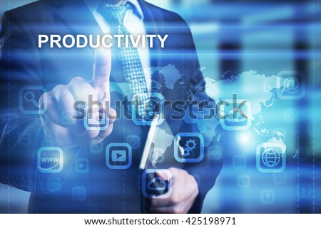 "Businessman is pressing on the virtual screen and selecting ""Productivity"". - stock photo"