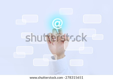 Businessman is pressing the Email button on the transparent screen. - stock photo