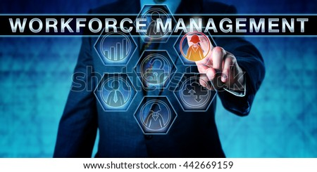 Businessman is pressing WORKFORCE MANAGEMENT on an interactive touch screen monitor. Human resource management metaphor and business software concept the development of a productive workforce. - stock photo