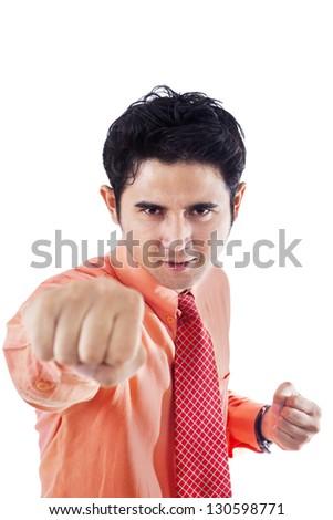 Businessman is punching something on white background - stock photo