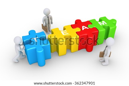 Businessman is pushing the last puzzle piece to complete the word TEAM and two others are watching