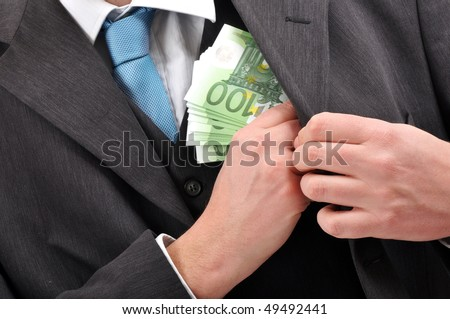 Businessman is putting euros banknotes money in pocket of his suite, financial corruption background - stock photo