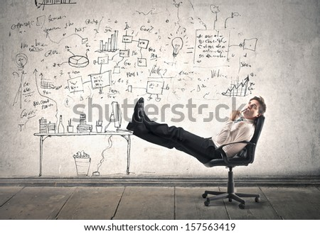 businessman is resting at work - stock photo