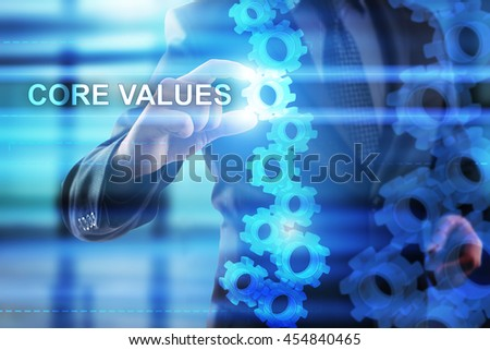 Businessman is selecting Core values on the virtual screen.