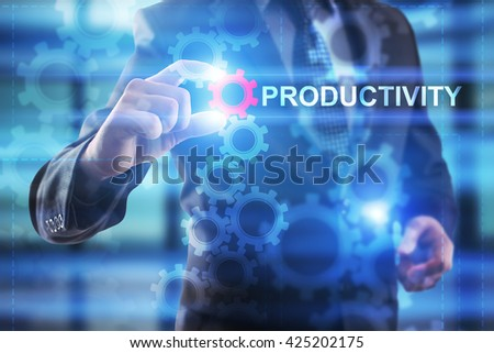 "Businessman is selecting ""Productivity"" on the virtual screen. - stock photo"